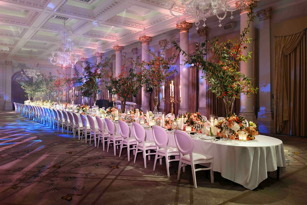 Long white table with autumnal table arrangements at The Langham London