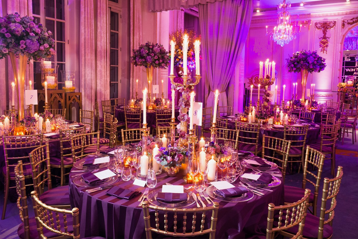Private dinner party with tall table centres in gold and purple at The Mandarin Oriental Hyde Park